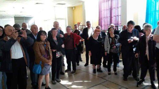 Le public de l'exposition pendant la conférence